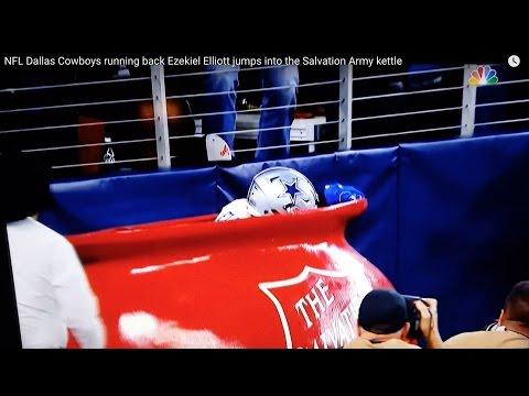 NFL Dallas Cowboys running back Ezekiel Elliott jumps into the Salvation Army kettle