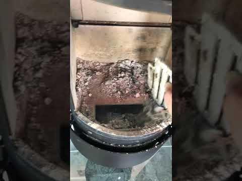 Removing the ash from Hwam stove