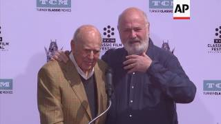Father-and-son Carl and Rob Reiner immortalized in cement at Chinese theater in Hollywood