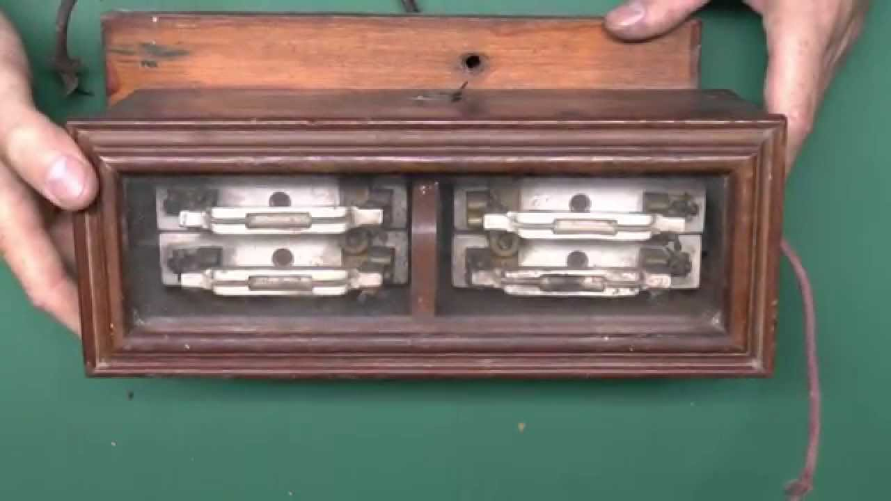 wooden fusebox with glass lid and ceramic rewireable fuses [ 1280 x 720 Pixel ]