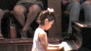 Iris, age 5, first recital after 8 piano lessons