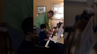 Kashyap piano beginner lesson with music notes