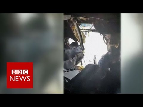Video shows gaping hole in plane fuselage - BBC News