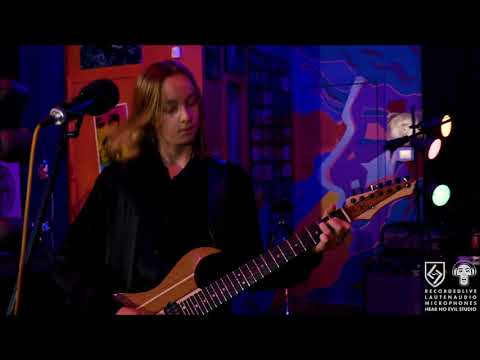 """War le Fäy playing original song """"Sinking in Solid"""" live at Hear No Evil Studio."""