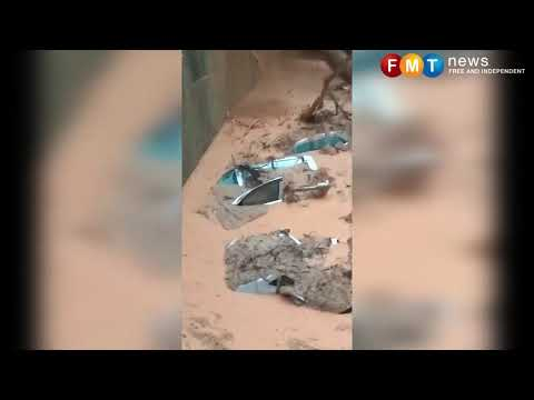 Flash floods drown Penang as Doksuri lashes
