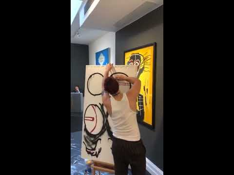 Ashton Painting The 5SOS Symbols At The Maddox Gallery In London