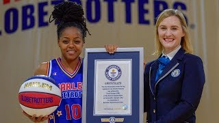 Most Basketball Under the Leg Tumbles in One Minute by a Female | Harlem Globetrotters