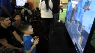 Stoked kid playing Broforce at South by Southwest 2015