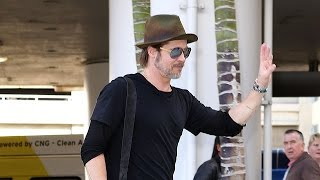 Brad Pitt Plays It Up For The Paps At LAX