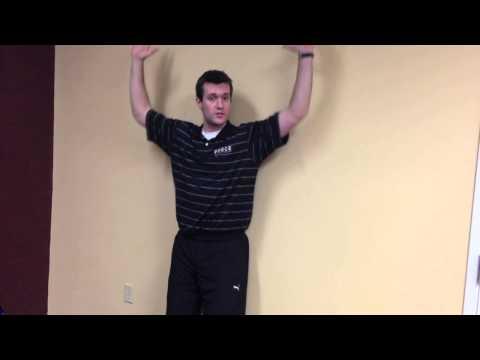 Waterloo chiropractors demonstrates shoulder pain screening technique