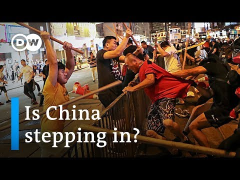 China's central government threatens Hong Kong protesters | DW News