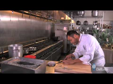 Chef Paul Qui demonstrates how to break down a fish