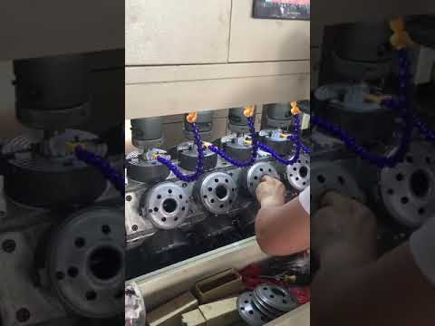 Truck oil filter tapping machine