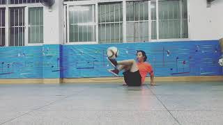 Freestyle Soccer Player Shows Tricks While Sitting on Floor - 1019469