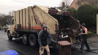 Simco Barker Running a Rear Load Garbage Route thumbnail