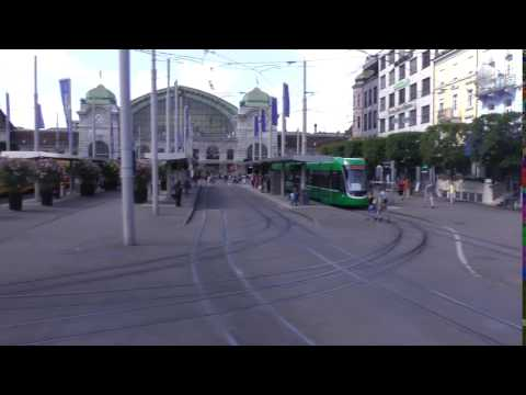 trams in front of Basel SBB station (main train station) in Basel, Switzerland