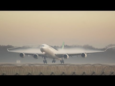 Amazing Overwing Vortex Mahan Air Airbus A340-642 Flight W5102 arrival at Muinch from Tehran EP-MMR