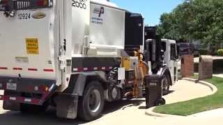 City of Plano: Crane Carrier Labrie Expert Dual Helping Hand