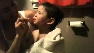 mom and child brushing teeth