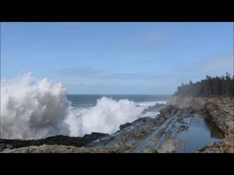 Giant Waves Crashing on Rugged Cliffs