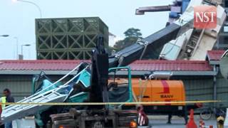 Toppled crane kills lorry driver