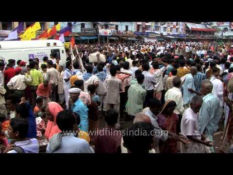 Crowds rally around the chariots during Jagannath Rath Yatra in Puri