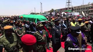 President Michael Sata's body returns to Zambia amid splits in ruling party