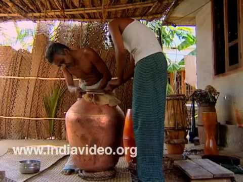 Making mizhavu, a pot shaped drum