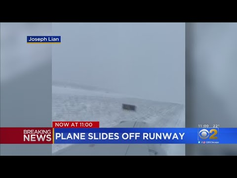 Mick Lee - American Airlines Flight Slides Off Icy Runway At O'Hare Airport
