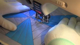 Watch Beginner Josh Free Motion Quilt Zigzags In A Pinwheel Quilt Block