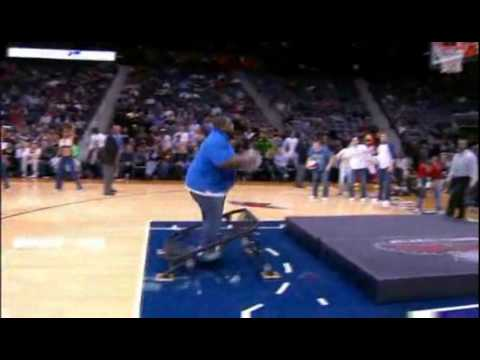 Fat Guy Trying To Dunk Off A Trampoline At The Hawks Game