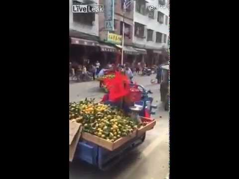 Orange Fruit Vendor Hits Inspector With Vehicle in China