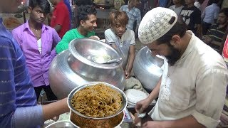 eating mutton biryani