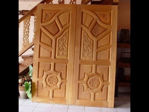 Kerala style wood work front door designs 2 youtube for Big main door designs