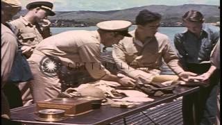 US sailors and officers check Japanese souvenirs aboard a submarine at a dock in ...HD Stock Footage