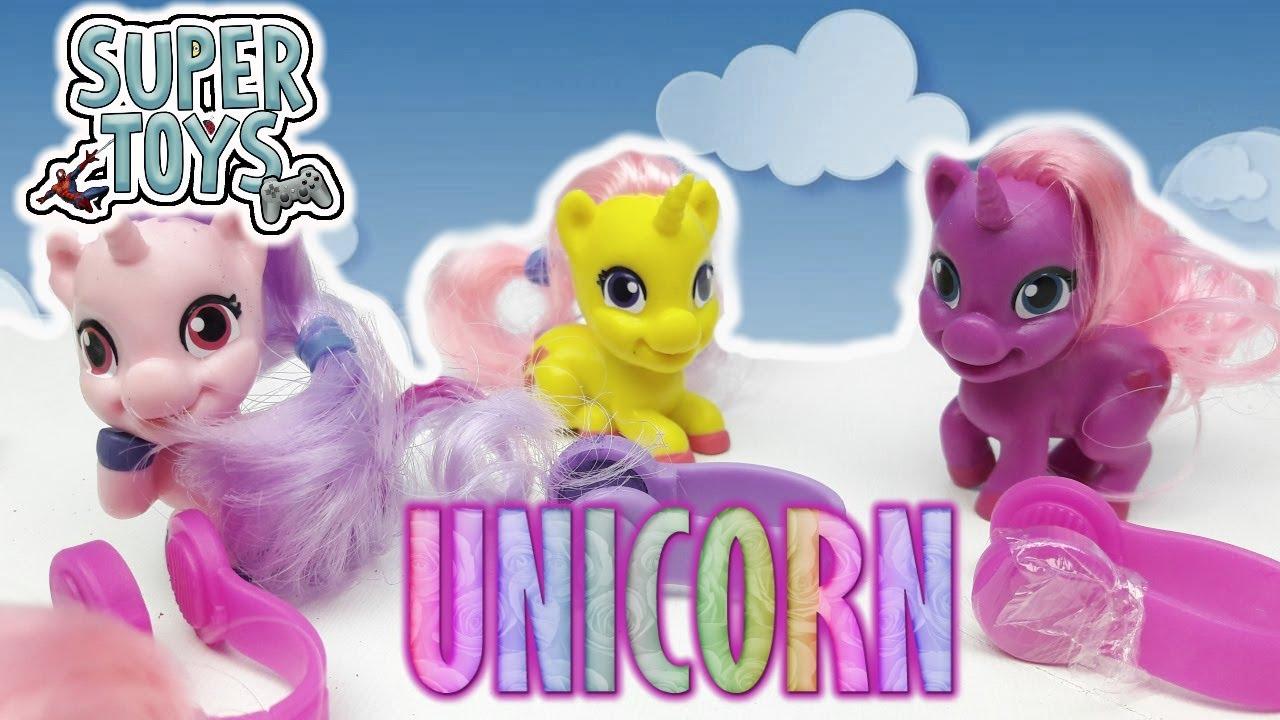 MAGIKI UNICORNI DA COLLEZIONARE , bustine in edicola , 12 unicorni con  chiome da colorare!