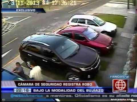 América Noticias: Cámara de seguridad registro el robo a vehículo bajo la modalidad del 'bujiázo'