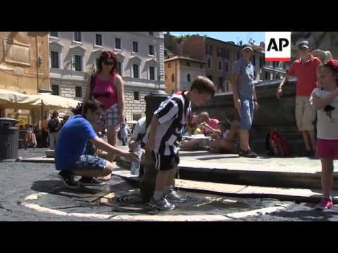 """Tourists in Rome seek relief from stifling heatwave dubbed """"Caligula"""""""