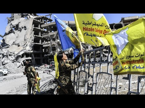 Syria: US-backed forces celebrate victory over IS group in Raqqa