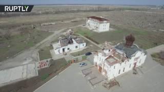 Беспилотник заснял разрушенный в ходе боевых действий монастырь близ Донецка