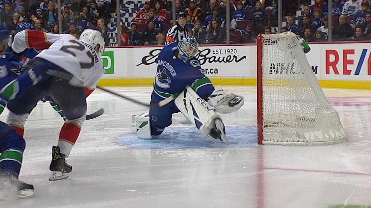 Jacob Markstrom extends for fantastic glove save on Bjugstad