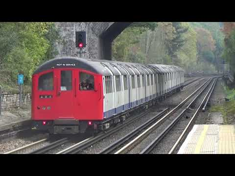 London Underground 1962 Stock 1407 and 1406 passing Chigwell