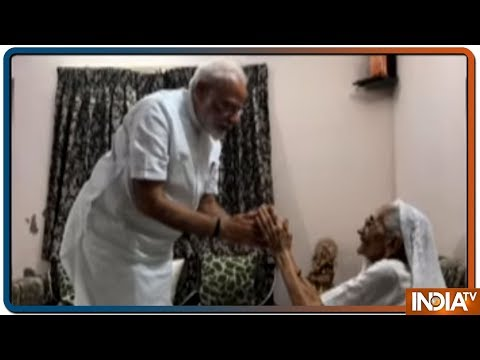Prime Minister Narendra Modi meets his mother in Gandhinagar and seeks her blessings