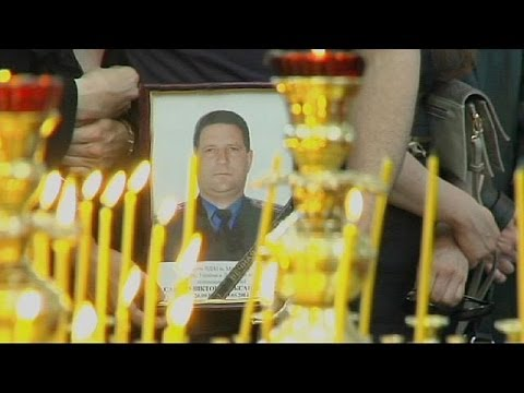 Ukraine: Funeral held for slain traffic police chief in divided Mariupol