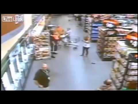 Man Kidnaps Child In SuperMarket Security Cam