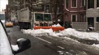 DSNY, NEW YORK CITY DEPARTMENT OF SANITATION, PLOWING THE STREETS OF NEW YORK CITY DURING THE STORM.