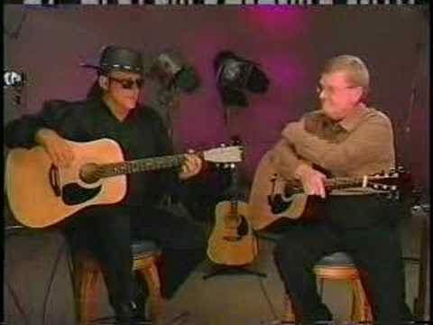 Esteban plays guitar with the Ronco knives dude
