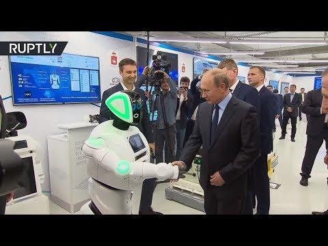 'Hello, Vladimir Putin!': Russian President shakes hand with 'Promorobot'