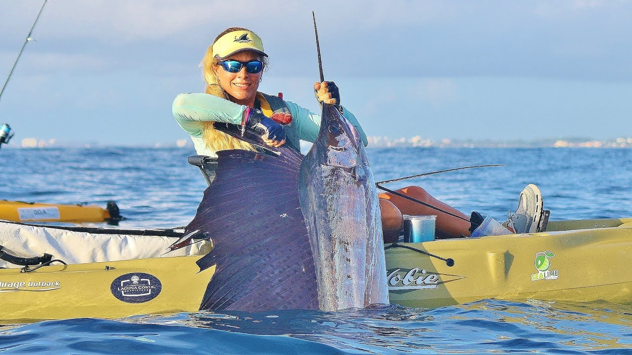 Ocean kayak fishing girl catches giant sailfish in the for Sea fishing kayak