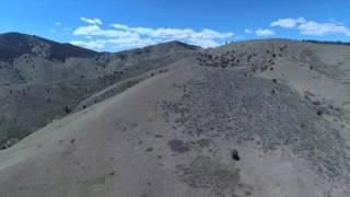 Flying in dry hills over Denver